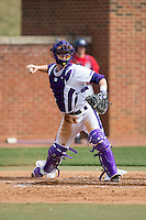 High Point Panthers catcher Spencer Brown (26) checks the runner at first base during game one of a double-header against the NJIT Highlanders at Williard Stadium on February 18, 2017 in High Point, North Carolina.  The Panthers defeated the Highlanders 11-0.  (Brian Westerholt/Four Seam Images)