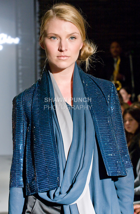 """Model walks the runway in a shawl collar top, sequin short jacket, and straight leg pant, during the Blanc de Chine 2010 Fall Winter """"The Elegance of the Ming Design"""" collection runway show on March 24, 2010."""