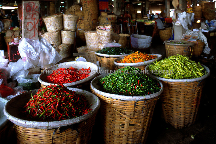 May, 2000-- Bangkok, Thailand..Chilis on sale at Bangkok's Pak Klong market...All photographs ©2003 Stuart Isett.All rights reserved.This image may not be reproduced without expressed written permission from Stuart Isett.