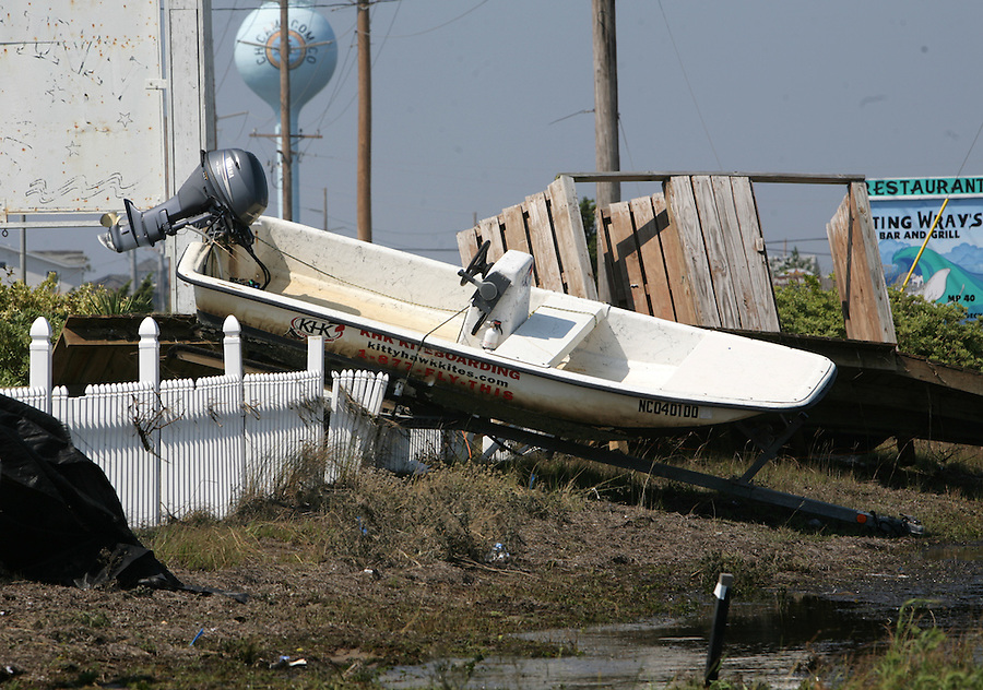 A boat balances on top of a fence in Rodanthe, NC,   on Sunday, Aug. 28, 2011, after extreme flooding from Hurricane Irene.  Photo by Ted Richardson