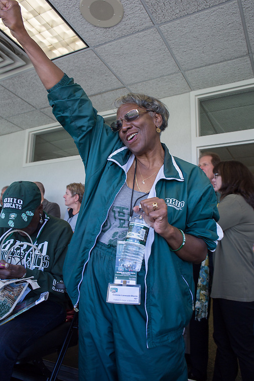 Connie Lawson-Davis, a member of the OUAA board of directors, cheers at the beginning of the Ohio University Homecoming football game on October 10, 2015 at Peden Stadium. Photo by Emily Matthews