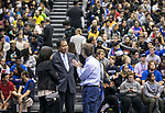 A. Gabriel Esteban, Ph.D., president of DePaul University, center, and his wife Josephine, left, talk with Doug Long, director for the office of the first-year programs, as they watch incoming students arrive at DePaul's McGrath-Phillips Arena Tuesday, Sept. 5, 2017, for New Student Service Day. Students fanned out across the city to volunteer at dozens of community organizations following the early morning rally on the Lincoln Park Campus. (DePaul University/Jamie Moncrief)