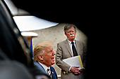 "United States President Donald J. Trump, left, speaks as National Security Advisor John R. Bolton, listens during a meeting with Klaus Iohannis, Romania's president, not pictured, in the Oval Office of the White House in Washington, D.C., U.S., on Tuesday, Aug. 20, 2019. Trump said today he's ""not ready to make a deal with China,"" but adds Beijing wants an agreement and something could happen soon. <br /> Credit: Andrew Harrer / Pool via CNP"
