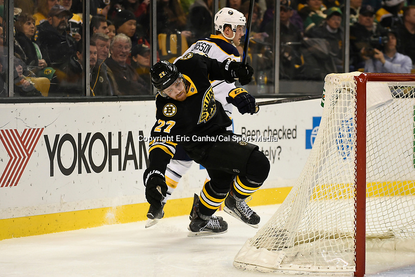 March 17, 2015 - Boston, Massachusetts, U.S. - Boston Bruins defenseman Dougie Hamilton (27) and Buffalo Sabres left wing Johan Larsson (22) in game action during the NHL match between the Buffalo Sabres and the Boston Bruins held at TD Garden in Boston Massachusetts. Buffalo defeated Boston 2-1 by shoot out. Eric Canha/CSM