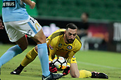 9th January 2018, nib Stadium, Perth, Australia; A League football, Perth Glory versus Melbourne City; Dean Bouzanis goalkeeper for Melbourne City gathers the cross from Perth Glory during the first half