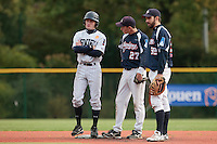 23 October 2010: Joris Bert of Rouen talks to Fabien Proust and Sebastien Boyer during Savigny 8-7 win (in 12 innings) over Rouen, during game 3 of the French championship finals, in Rouen, France.