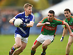 Podge Collins of  Cratloe in action against Shane Hickey of Kilmurry Ibrickane during their senior football final replay at Cusack park. Photograph by John Kelly.