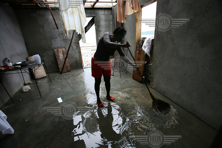 Amelta Pierre mops out her house that was destroyed by Hurricane Dean.
