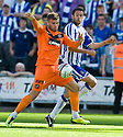 DUNDEE UTD'S DAVID GOODWILLIE HOLDS OFF KILMARNOCK'S TIM CLANCY