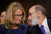 Professor Christine Blasey Ford, who has accused U.S. Supreme Court nominee Brett Kavanaugh of a sexual assault in 1982, confers with her attorney Michael Bromwich while testifying before a Senate Judiciary Committee confirmation hearing for Kavanaugh on Capitol Hill in Washington, U.S., September 27, 2018. REUTERS/Jim Bourg