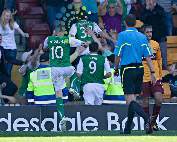 Liam Miller jumps into the crowd after making it 3.1 to Hibs during The Clydesdale Bank Premier League match between Motherwell and Hibernian at Fir Park 15/08/10..Picture by Ricky Rae/universal News & Sport (Scotland).