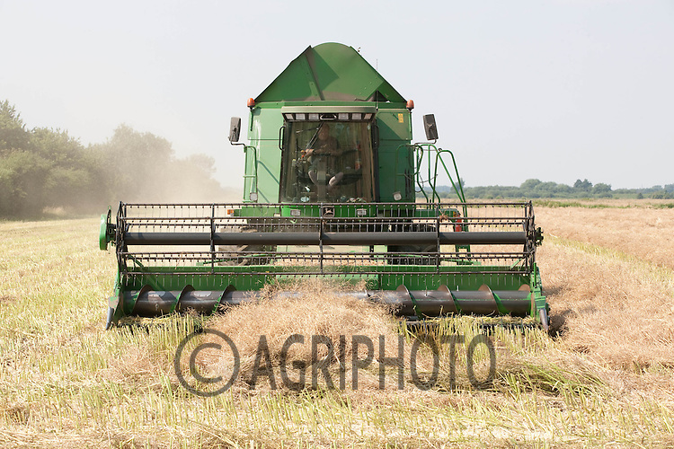 John Deere combine harvests oil seed rape near Baston,Lincolnshire