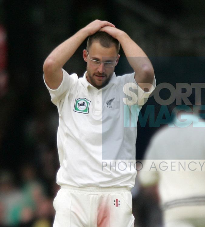New Zealand's Daniel Vettori looks on dejected