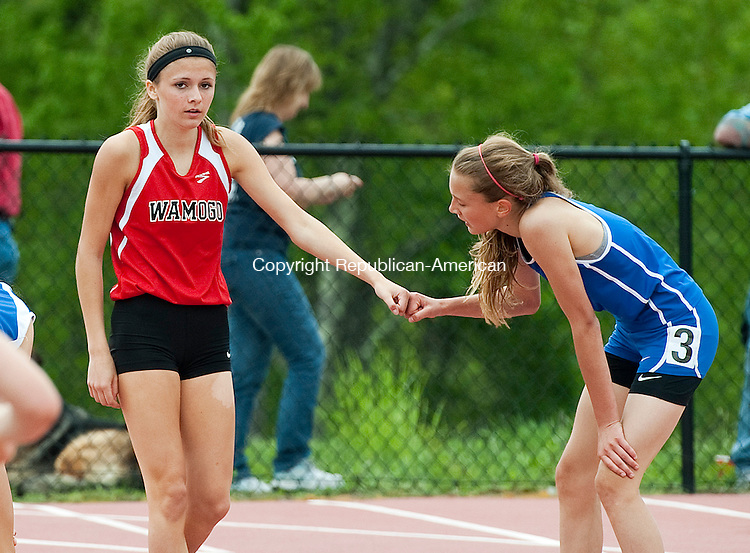 LITCHFIELD, CT--051615JS14- Wamogo's Brooke Neller received congratulations from Nonnewaug's Mary Bibbey after winning the 800 M run during the Berkshire League Track and Field championships Saturday at Plumb Hill Field Complex at Litchfield High School.  <br /> Jim Shannon Republican-American