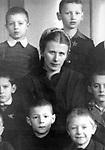 Maria Alexeevna Valentey with her pupils. A fragment of the photo of the group (1950s) / Мария Алексеевна Валентей среди своих учеников. Фрагмент груповой отографии (1950-е).