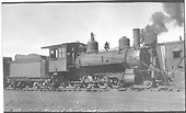 3/4 engineer's-side view of D&amp;RGW locomotive #421 in storage with parts missing.<br /> D&amp;RGW  Alamosa, CO  Taken by Perry, Otto C. - 6/6/1923