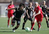 Eriko Arakwa (30) and Becky Sauerbrunn (22). Washington Freedom defeated FC Gold Pride 4-3 at Buck Shaw Stadium in Santa Clara, California on April 26, 2009.