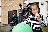 An Hasidic girl sucks on an ice lolly outside her rented house. Hasidic families stay in Pentre Jane Morgan university accommodation when they holiday in Aberystwyth. Every other day, bread, milk and other supplies are brought from Kosher shops in London and resold from one of the rented houses on the campus.
