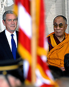 Washington, DC - October 17, 2007 -- United States President George W. Bush and The 14th Dalai Lama, Tenzin Gyatso, watch the presentation of the colors at The Capitol in Washington, D.C. The Dalai Lama was at The Capitol to accept the Congressional Gold Medal, the nation's highest and most distinguished civilian award, on Wednesday, October 17, 2007. .Credit: Ron Sachs/CNP