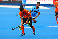 Najmi Jazlan controls the ball for Malaysia during the Hockey World League Quarter-Final match between India and Malaysia at the Olympic Park, London, England on 22 June 2017. Photo by Steve McCarthy.