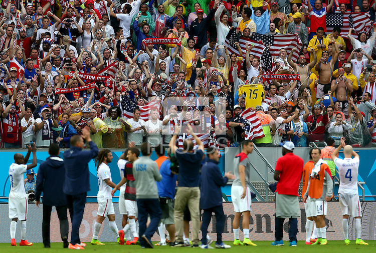 USA supporters celebrate at full time as they progress to the next round despite defeat to Germany
