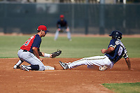 Cleveland Indians Mark Mathias (23) tags out George Iskenderian (8) during an instructional league game against the Milwaukee Brewers on October 8, 2015 at the Maryvale Baseball Complex in Maryvale, Arizona.  (Mike Janes/Four Seam Images)