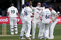 Simon Harmer of Essex is congratulated by his teammates having taken the wicket of Tom Moores during Essex CCC vs Nottinghamshire CCC, Specsavers County Championship Division 1 Cricket at The Cloudfm County Ground on 16th May 2019