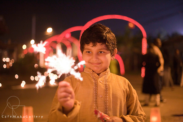 Divali,Hindu festival of light, beautiful young Trini-Indian boy with  a starburst from a deya