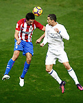 Atletico de Madrid's Stefan Savic (l) and Real Madrid's Cristiano Ronaldo during La Liga match. November 19,2016. (ALTERPHOTOS/Acero)