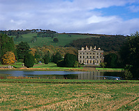 View of Curraghmore over the lake with the park rising up behind the house