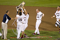 The South Carolina Gamecocks grab the trophy after winning the NCAA Division One Men's College World Series on June 29th, 2010 at Johnny Rosenblatt Stadium in Omaha, Nebraska.  (Photo by Andrew Woolley / Four Seam Images)