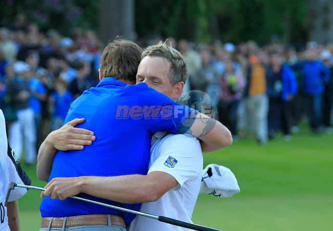 Luke Donald (ENG) gives caddy John McClarren a hug after winning the tournament and also becoming World No.1 at the end of the Final Day of the BMW PGA Championship at Wentworth Club, Surrey, England, 29th May 2011. (Photo Eoin Clarke/Golffile 2011)