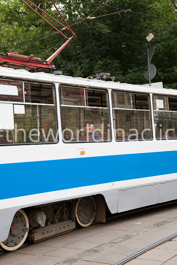 RUSSIA, Moscow. Man on tram in city center.