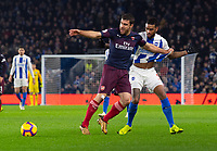 Brighton & Hove Albion's Jurgen Locadia (right) battles with Arsenal's Sokratis Papastathopoulos (left)  <br /> <br /> <br /> Photographer David Horton/CameraSport<br /> <br /> The Premier League - Brighton and Hove Albion v Arsenal - Wednesday 26th December 2018 - The Amex Stadium - Brighton<br /> <br /> World Copyright © 2018 CameraSport. All rights reserved. 43 Linden Ave. Countesthorpe. Leicester. England. LE8 5PG - Tel: +44 (0) 116 277 4147 - admin@camerasport.com - www.camerasport.com