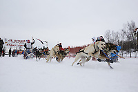 Taylor Steele and dog team leaves the start line of the 2013 Junior Iditarod on Knik Lake.  Knik Alaska..Photo by Jeff Schultz/IditarodPhotos.com   Reproduction prohibited without written permission