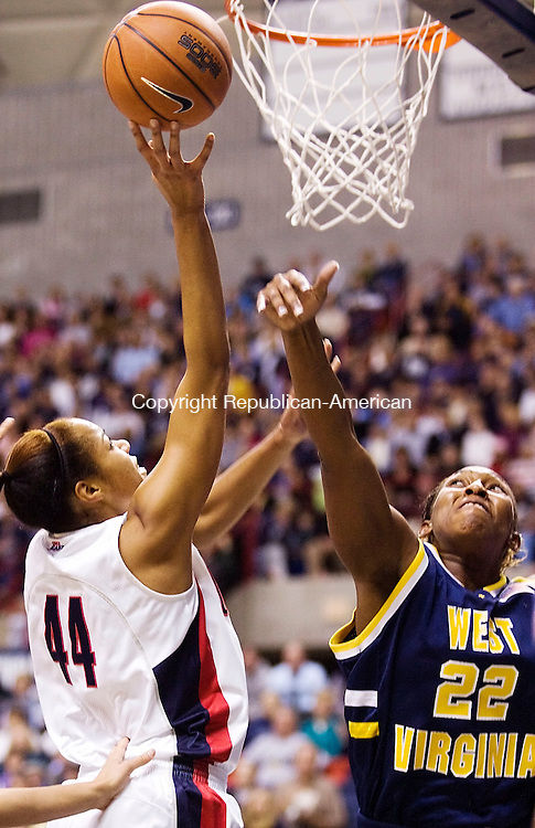 STORRS--9 January 07--010908TJ07 - UConn's Brittany Hunter (44) sends up a shot under pressure from West Virginia's Chakhia Cole (22) during UConn's 84-48 win against West Virginia on Wednesday, January 9, 2008. (T.J. Kirkpatrick/Republican-American)