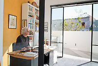 Frank working in his home office. Kathleen Cammarata and Frank Thoms´ house in San Miguel de Allende, Mexico. Adam Wiseman for The Wall Street Journal. ID 23453 COURTYARDS-Mexico (Thoms)
