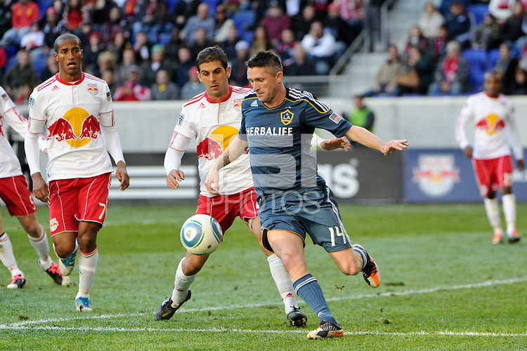 Robbie Keane (14) of the Los Angeles Galaxy is defended by Carlos Mendes (44) of the New York Red Bulls during the 1st leg of the Major League Soccer (MLS) Western Conference Semifinals at Red Bull Arena in Harrison, NJ, on October 30, 2011.