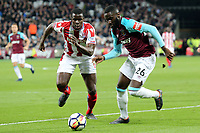 Kurt Zouma of Stoke City and Arthur Masuaku of West Ham United during West Ham United vs Stoke City, Premier League Football at The London Stadium on 16th April 2018