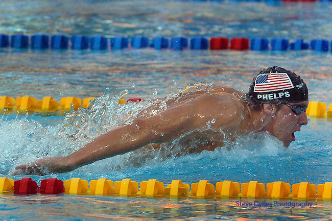 USA swimmer Michael Phelps swims the Butterfly leg of his World Record and Gold Medal winning time in the 400 Individula Medley. His was the first Gold Medal won by the US in the 2004 Summer Olympic Games in Athens, Greece on Saturday, August 14th, 2004...     DENVER POST PHOTO BY STEVE DYKES.