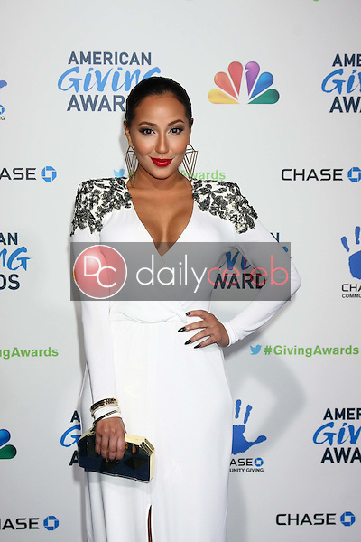 LOS ANGELES - DEC 7:  Adrienne Bailon arrives to the 2012 American Giving Awards at Pasadena Civic Center on December 7, 2012 in Pasadena, CA