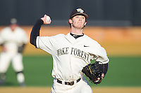 Wake Forest Demon Deacons starting pitcher Jack Fischer (15) in action against the Towson Tigers at Wake Forest Baseball Park on February 15, 2014 in Winston-Salem, North Carolina.  (Brian Westerholt/Four Seam Images)