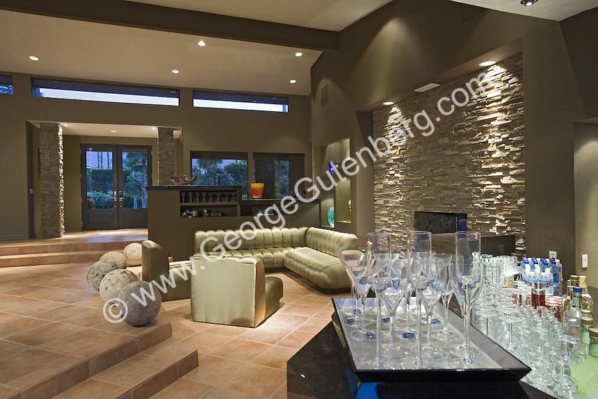 Wet bar overlooks modern living room