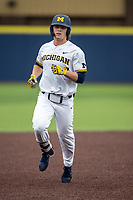 Michigan Wolverines outfielder Jesse Franklin (7) jogs around the bases after hitting a home run during the NCAA baseball game against the Michigan State Spartans on May 7, 2019 at Ray Fisher Stadium in Ann Arbor, Michigan. Michigan defeated Michigan State 7-0. (Andrew Woolley/Four Seam Images)