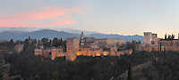 The Alhambra Palace, Granada, Andalusia, Southern Spain, with the Comares Tower, built in the 14th century under Muhammad V, the tallest tower in the Alhambra and housing the Hall of the Ambassadors, Nasrid Palaces and the Palace of Charles V in the background, built by Pedro Machuca in the 16th century. The Alhambra was begun in the 11th century as a castle, and in the 13th and 14th centuries served as the royal palace of the Nasrid sultans. The huge complex contains the Alcazaba, Nasrid palaces, gardens and Generalife. Behind are the snow-capped peaks of the Sierra Nevada. Picture by Manuel Cohen