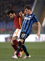 Calcio, Serie A: Roma vs Inter. Roma, stadio Olimpico, 19 marzo 2016.<br /> Roma's Mohamed Salah, left, is challenged by FC Inter's Adem Ljajic during the Italian Serie A football match between Roma and FC Inter at Rome's Olympic stadium, 19 March 2016. The game ended 1-1.<br /> UPDATE IMAGES PRESS/Isabella Bonotto