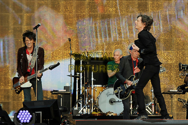 Ronnie Wood, Charlie Watts, Keith Richards and Mick Jagger of The Rolling Stones <br /> performing at Barclaycard British Summertime, Hyde Park, London, England, UK, <br /> 13th July 2013.<br /> music concert gig festival live on stage full length black shirt microphone band group playing guitar side group band drummer drums <br /> CAP/MAR <br /> &copy; Martin Harris/Capital Pictures