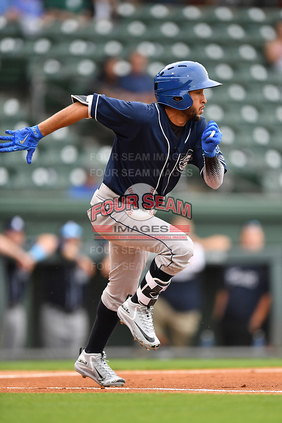 Second baseman Carlos Herrera (2) of Asheville Tourists runs toward first in a game against the Greenville Drive on Wednesday, May 3, 2017, at Fluor Field at the West End in Greenville, South Carolina. Greenville won, 8-0. (Tom Priddy/Four Seam Images)