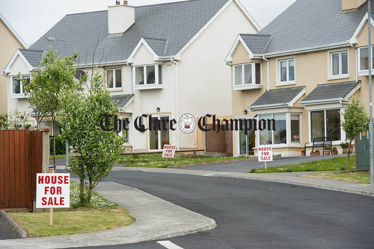 "A view of of some of the ""For Sale"" signs erected outside houses in the Beal An Inbhir estate at in Kilrush. Photograph by John Kelly."