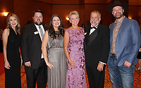 NWA Democrat-Gazette/CARIN SCHOPPMEYER Casey  Cowan (from left), Mike Williams, Melanie Brecht, Diana and Kent Eikenberry and Sach Oliver help welcome guests to the Jewels of Giving Gala on Nov. 16.